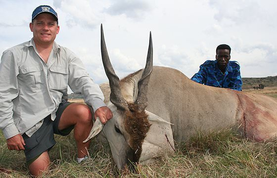 A hunter presents his eland trophy for a photograph.