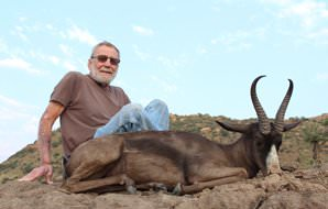 A proud hunter with his unique black springbok trophy.