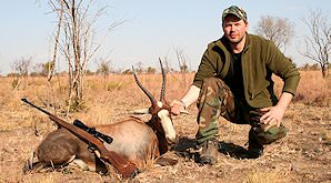 A hunter holds up the head of his blesbok trophy.