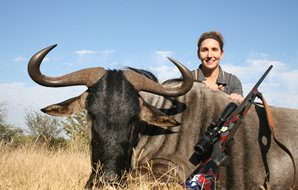 A huntress with her blue wildebeest trophy.