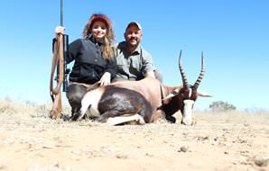 A huntress with her professional hunter and bontebok trophy.