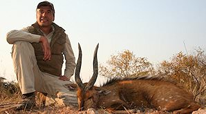 A bushbuck trophy is presented for a photo.
