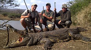 A team of hunters with their crocodile trophy in Zimbabwe.
