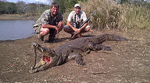 A hunter with his crocodile trophy and professional hunter.