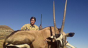 A hunter smiles above his gemsbok trophy.