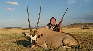 A hunter sits behind his gemsbok trophy in the Free State.