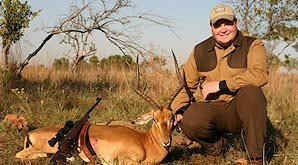 An impala ram is presented for a hunting shot.
