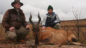 Red hartebeest trophies presented for a commemorative shot.