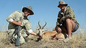 A hunter poses with his springbok trophy and professional hunter.