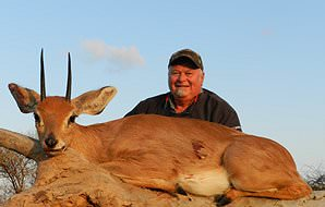 A steenbok trophy is presented for a photograph.