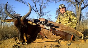 A hunter smiles with his tsessebe trophy.