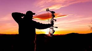 A hunter draws his bow.
