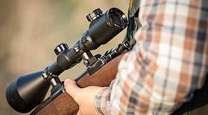 A scope on a rifle.