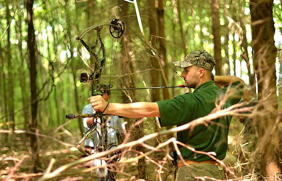 A bow hunter prepares to take his shot.