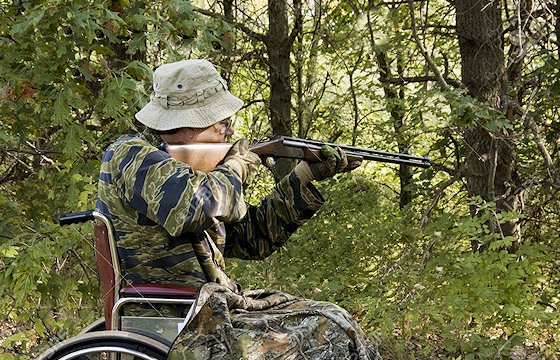 A hunter in a wheelchair prepares to take his shot.