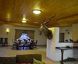 A kudu trophy welcomes guests to the dining room.