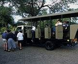 Guests prepare to depart on an open-air game drive in the Kruger Park.