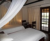 A plush twin share bedroom at the Binga camp in Zimbabwe.