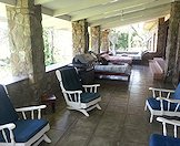 Chairs and day beds on the patio.