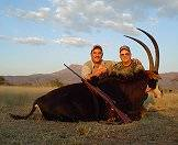 A proud pair of hunters with their sable antelope trophy.