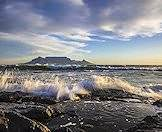 Table Mountain rises up from the Atlantic Ocean.