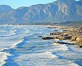 A backdrop of mountains frame the shores of the Cape peninsula.