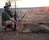 A common reedbuck hunted at dusk.