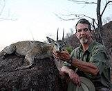 A hunter proudly displays his klipspringer trophy.