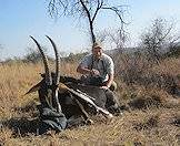 Frans Gresse with a sable antelope trophy.