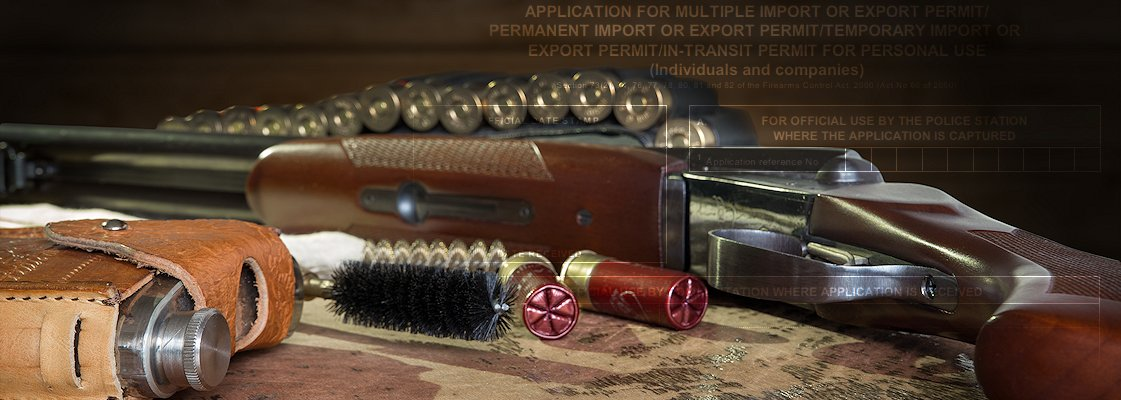 A close up of a rifle and bullets.