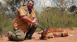 Proud hunter with his impala trophy.